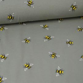 Tissu jersey Oeko tex motifs abeilles fond gris