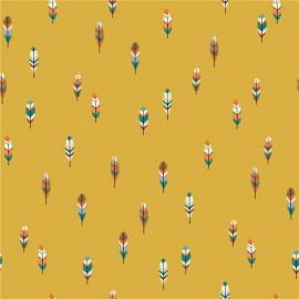 Tissu coton motif plumes fond moutarde. Oeko tex