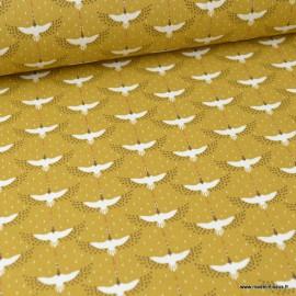 Tissu coton Enduit  imprimé Grues oiseaux fond Caramel -  Oeko tex