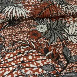 Tissu Rayon fluide motifs feuilles de palme fond tomette - au mètre
