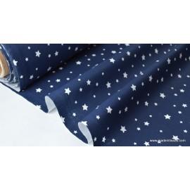 Tissu coton imprimé dessin étoiles multi marine .x1m