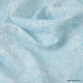Tissu Popeline Crinkle motifs fleurs fond bleu - Oeko tex
