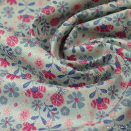 Tissu Popeline en coton Bio & oeko tex motifs fleurs fond vert Céladon