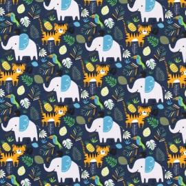 Tissu jersey french terry motifs lions et éléphants dans la jungle Indigo  - Oeko tex