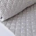 Tissu Matelassé coton double face étoiles et zigzag .x1m