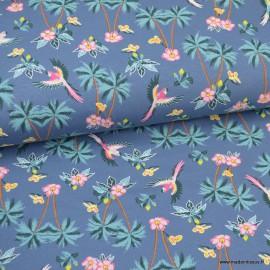Tissu jersey motifs perroquets et palmiers fond jean - Oeko tex