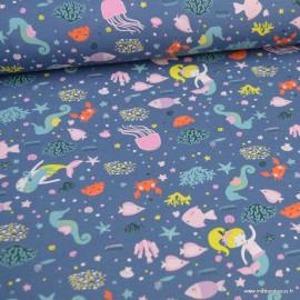 Tissu jersey motifs Sirènes et poissons fond jean - Oeko tex