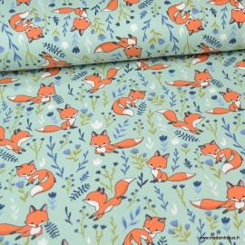 Tissu jersey motifs renards et fleurs fond menthe - Oeko tex