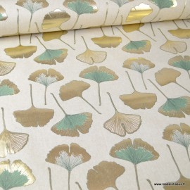 Tissu toile aspect lin motifs Gingko Biloba vert et or