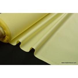 Tissu imperméable étanche polyester enduit acrylique jaune .