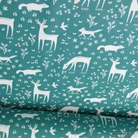 Tissu coton Belforet motifs biches et renards fond sapin - Oeko tex