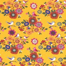 Tissu jersey French terry Oeko tex motifs oiseaux et fleurs fond Moutarde