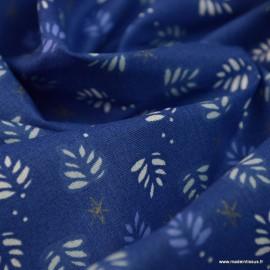 Tissu coton Joona motifs feuilles et étoiles de Noël or et bleu - Oeko tex