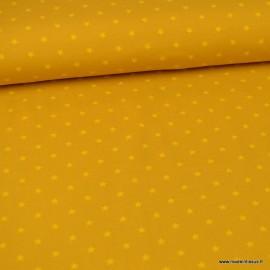 Tissu jersey Oeko tex motifs étoiles fond Ocre