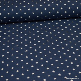 Tissu jersey Oeko tex motifs étoiles fond bleu marine