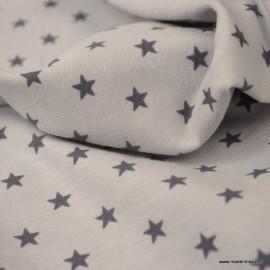 Tissu jersey Oeko tex motifs étoiles fond gris clair