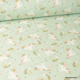 Tissu coton Omma motifs Licornes et arc en ciel fond Céladon - oeko tex