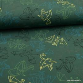 Tissu jersey French terry Oeko tex motifs dragons fond vert