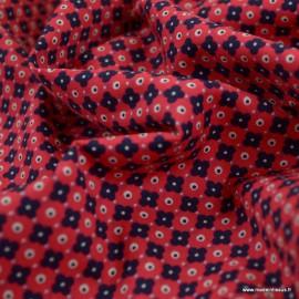 Tissu coton popeline motifs fleurs graphiques marine fond fuchsia