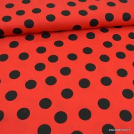 Tissu Popeline coton imprimé gros pois noir fond Rouge