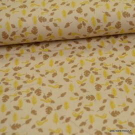 Tissu coton popeline motifs feuilles et oiseaux fond beige