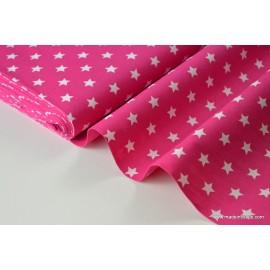 Tissu popeline coton fuchsia étoiles blanches . x1m