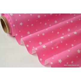 Tissu coton imprimé dessin étoiles multi fuchsia . x1m