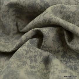 Tissu coton popeline motifs fleurs grises fond gris clair