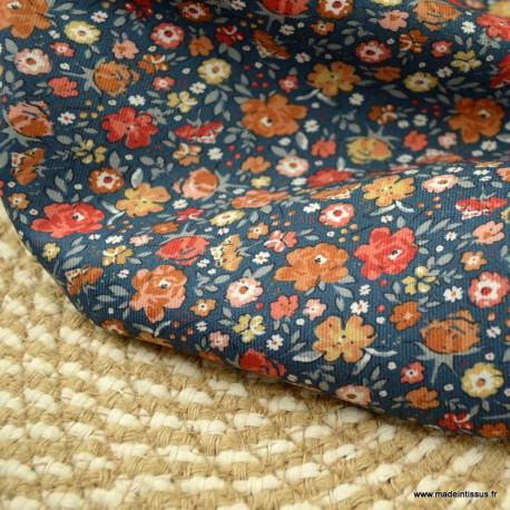 Sergé de viscose motifs fleurs fond bleu denim