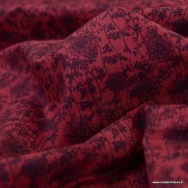 Tissu coton popeline motifs fleurs prune fond grenat