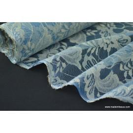 Tissu Dentelle pour robe de mariée bleu or .