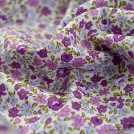 Tissu Popeline coton imprimé fleurs violet et parme