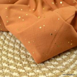 Tissu jersey Terracotta à pois dorés