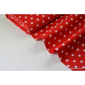 Tissu popeline coton rouge étoiles blanches . x1m