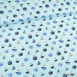 Tissu Popeline motifs bateaux fond bleu - oeko tex
