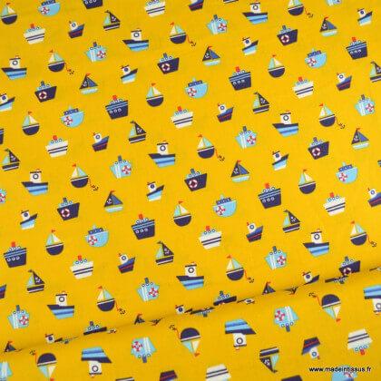 Tissu Popeline motifs bateaux fond moutarde - oeko tex