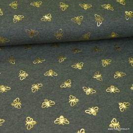 Tissu jersey motifs abeilles dorés anthracite