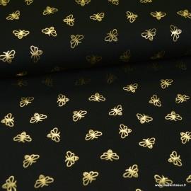 Tissu jersey motifs abeilles dorés fond noir