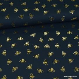 Tissu jersey motifs abeilles dorés fond marine
