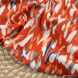 Tissu Jersey Viscose motifs abstrait fond orangé