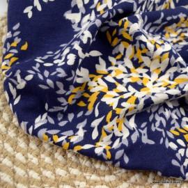 Tissu Jersey Viscose motifs feuilles ocre fond marine