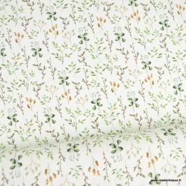 Tissu jersey Oeko tex motifs brindilles vertes fond blanc cassé