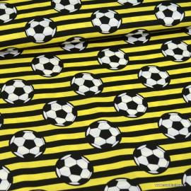 Tissu Popeline motif ballon de foot fond jaune - oeko tex