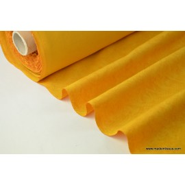 tissu faux uni moutarde pour nappe et décoration ..x 1m