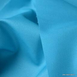 Tissu Gabardine enduite étanche turquoise.