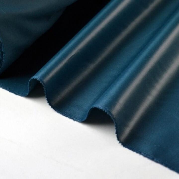 Tissu polyester petrole déperlant pour parapluie .