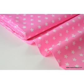 Tissu popeline coton rose étoiles blanches . x1m