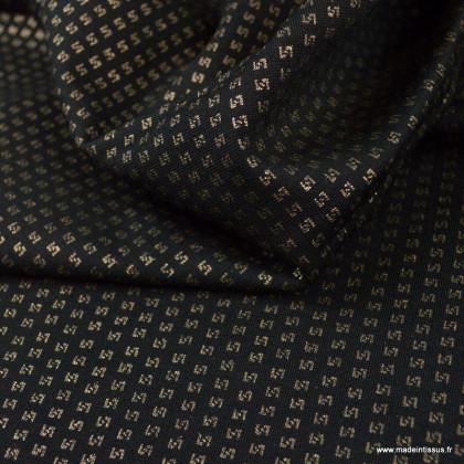 Tissu Jersey milano motifs graphique or fond noir