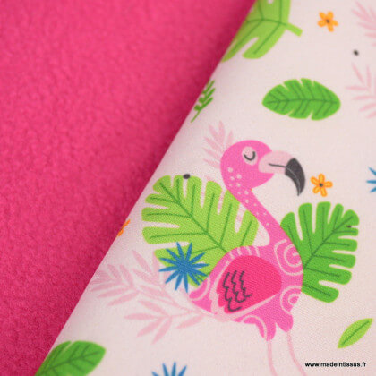 Tissu Softshell motifs flamants et feuilles tropicales fond rose clair