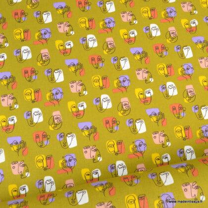 Tissu coton Pablo motifs visages fond curcuma - Oeko tex